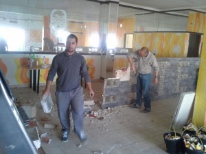 Charter members removing the blocks from the old bar counter in our future large, multi-purpose room